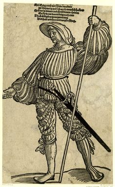 Landsknecht Gall from Unterwalden; WL figure, frontal view, his head in TQ profile to l, holding a lance in his l hand; the l leg stretched away to r.  Woodcut and letterpress  Landsknechte (Lansquenets)  1525-1542  Item number: AN61210001  British Museum