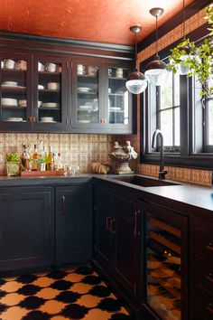 In this kitchen, the homeowners  chose to make their ceiling a pumpkin color.