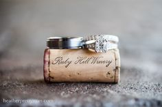 Cute picture to show rings, use custom made corks with our names and some from the winery