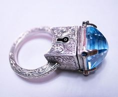 Sterling Silver Engraved Topaz Locking Poison Ring with Key on Chain, by William Llewellyn Griffiths Jewelry Box, Jewelry Rings, Jewelry Accessories, Jewelry Design, Jewellery, The Sapphires, Poison Ring, Topas, Black Box