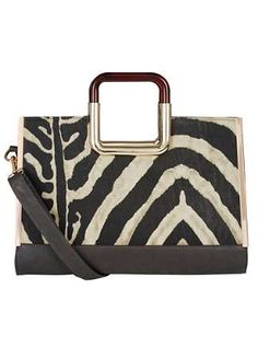 08fc48fa1b0 Lotus Zebra Print Bag Fallabella from Lotus is the perfect arm candy for  those who like