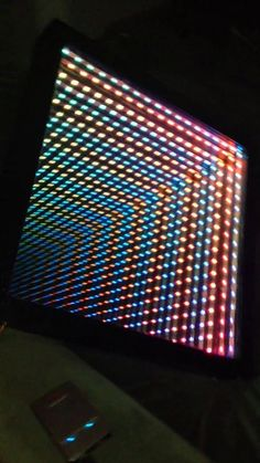 Infinity mirror running a test pattern. Sorry for the portrait recording :