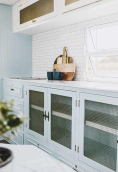 Old glass cupboard fronts were removed in the renovated kitchen and given a style update with brass wire netting. White subway tiles form the splashback in The Block's Michael and Carlene's renovated vintage retro camper van caravan. Verde Vintage, Vintage Rv, Vintage Caravans, Vintage Vans, Vintage Travel Trailers, Vintage Caravan Interiors, Caravan Decor, Retro Caravan, Retro Campers