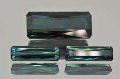 set of neon blue african tourmalines. MdMaya Gems http://mdmayagems.com/collections/blue-green/products/set-of-3-neon-blue-african-tourmaline-octagon-baguette-cut-12-18-ct-set-dont-miss-it