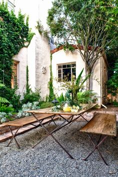 Love this sitting area landscaped in fern and gravel but what ties it all together is the great bench!