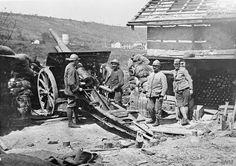 French gunners manning a 105 mm gun during an artillery barrage in the Verdun region.