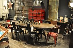 the table and chairs areso vintage-industrial...I love the red storage unit....k