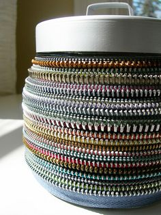 These decor items are made using vintage zippers in a variety of ways.  The jars and vases incorporate many colors and textures to make unique  and stunning display pieces. Amalia Versaci finds making the magnets is a great way to  use some the slides that may not be suitable for jewelry, but... #Metal, #Vase, #Zipper