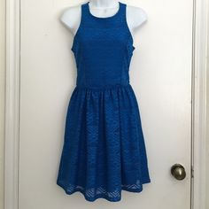 Blue Gianni Bini dress Super pretty dress perfect for spring time all blue but has a tribal pattern to it gently used Gianni Bini Dresses