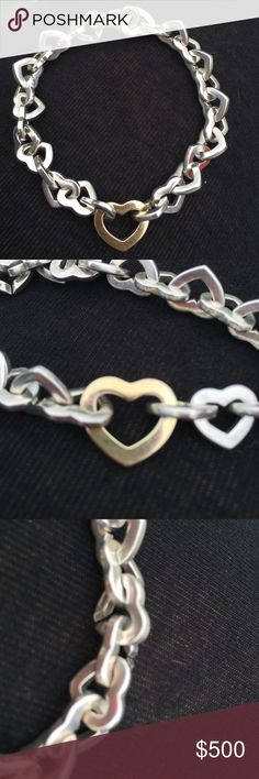 """Tiffany & Co. Heart Link Bracelet Silver/18k Gold Tiffany & Co. Sterling silver and 18k gold Heart Link Bracelet. Sterling Silver hearts link from end to end, meeting a larger 18k gold heart in the center. This bracelet is NO LONGER sold by Tiffany (they """"retired"""" it) so it truly is one of a kind and quite rare! The bracelet is stamped 925 750. All reasonable offers will be considered!!!  Tiffany & Co. Jewelry Bracelets"""