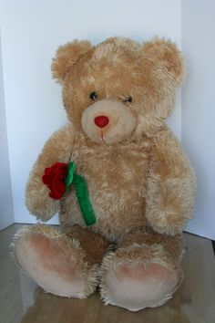 "Adorable Large Teddy bear with an attached red velvet rose, measures 33"" height.  This comes from a pet and smoke free environment."