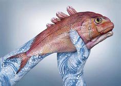 Pintura artistica de animais feitas nas mãos