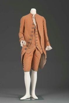 Man's suit, 1775-90, French or English; Velvet; uncut and figured voided silk velvet, buttons covered with silver and gilt-silver wire and sequins, red and gilt textured foil, gilt silver embroidered white silk kneebands