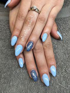 Pale blue almond shaped nails