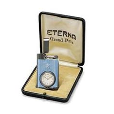 ETERNA MANUFACTURED CIRCA 1930 AN UNUSUAL SILVER AND ENAMEL LIGHTER-FORM WATCH WITH ORIGINAL FITT...