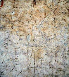 "The Graffito of Alexamenos.  Ancient graffiti found in the corner of the Palatine museum in Rome - sketch of a crucified man with the head of an ass, a person with arms extended next to him.  The words: ""Alexamenos worships [his] God."""