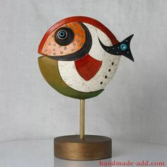 This fish has 2 different faces. Fish Pottery Decor, Colorful Ceramic Fish, Pottery Figurine fish with hand unique painted decoration, Unique home decor. This is an original work of art. Ceramic Fish, Ceramic Birds, Fish Sculpture, Sculptures, Garden Deco, Earthenware Clay, Funky Art, Pottery Designs, Statue