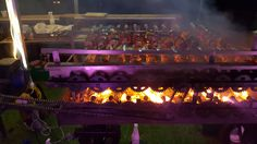 From the back you can see what makes are amazing Brazilian BBQ rotisserie work...cogs turning and fire = delicious meat by Fabulous BBQ