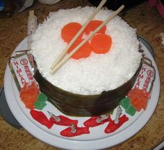 fruit roll ups for seaweed, gummy fish, chop sticks, coconut for rice, etc...this cake's right up my alley- its what penguins eat!