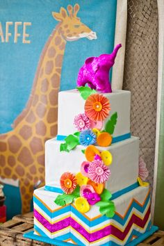 Safari cake: Hey There, Cupcake! Animal Canvas print: Pottery Barn Kids. Dessert station design by Sweets Indeed