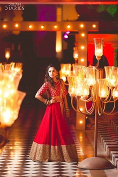 Red bridal lehenga with can can , sabyasachi bridal lehenga , crop top ehenga