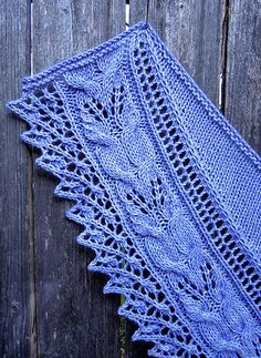 Lilyanna is a crescent-shaped shawl with a gorgeous 3-dimensional lace and cable border featuring botanical motifs that resemble calla lilies intertwined with ferns, A wide lace edging that looks like little rosebuds adorns the bottom curve of the shawl. The simplicity of the classic stockinette body, which is shaped by German short rows, allows the border pattern to take center stage. And the best part is that although the border lace pattern appears complex, it is easy to work and knits up…