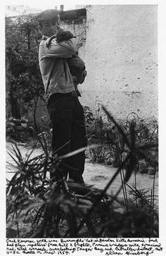 Jack Kerouac with William Burroughs' cat, 1957.
