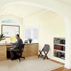 A large archway connects this office/library to an attic master bedroom and bath. See the complete remodel here.   Photo: William Enos   thisoldhouse.com