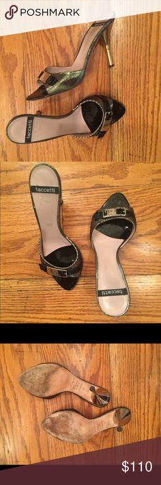 Creazioni Taccetti Vintage Heeled Sandals Unique! These sexy heeled sandals have a silver metallic upper, covered by a black strap and silver buckle with logo that accentuates the open toe.  The same silver detail continues along the edge of the brand embossed insole. The ~3.5 inch heel is a two-tone silver to gold tapered heel. Leather sole, insole and strap across toe.  There are a few nicks from normal wear (i.e. #4 right insole, left edge at heel) but still love these shoes! Creazioni…