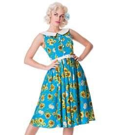 Beautiful 50's vintage style day dress with fitted bodice and inverted pleat detail to skirt.