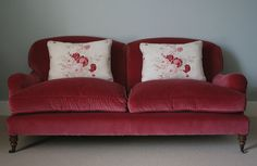 A classic combination of Velvet Red & Roses creates a gorgeously styled sofa.  #livingroom #sofa