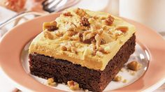 Enjoy these delicious brownie squares topped with pecans that are perfect for a dessert.