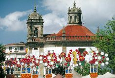 The market day decorations in Barcelos with the octagonally-shaped church of Senhora da Cruz behind