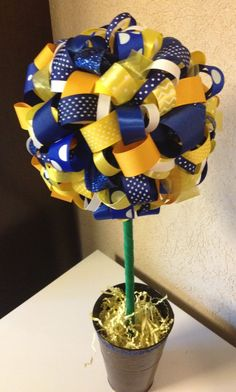 Blue, Yellow (Gold) and White Ribbon Topiary. Michigan, West Virginia Mountaineers (WVU), Notre Dame, San Diego Chargers and other colleges and professional football and baseball teams. Also great for little league and high school sports teams.