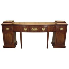 Elegant Adams Style English Mahogany Sideboard | Elegant Adams Style English Mahogany Sideboard  $8,950  IN THE STYLE OF:	George III  circa 1890 Mahogany and brass  HEIGHT:	37.75 in.  WIDTH:	8 ft. 2 in. DEPTH:	23.25 in.