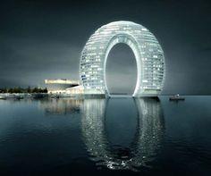 Sheraton Huzhou Hot Spring Resort, a luxury resort located in Huzhou, near Shanghai, China. It looks like a gigantic donut, which glows #travel #china #hotel