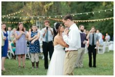 Backyard Vintage Wedding Part II. Lots of vintage decor ideas, strings of lights, shabby chic touches, and hanging window frames and other upcycled decor strung from trees.