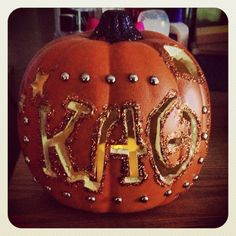 Getting ready for fall! #kappaalphatheta style. Just take a fake pumpkin and carve it then decorate however you want!