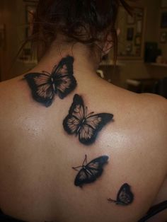 Black butterfly tattoos on back