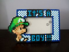 My kids will absolutely hate me :)    Luigi It's a Boy Maternty Perler Frame. $20.00, via Etsy.