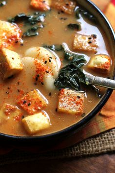 Spicy Miso Soup with Korean Rice Cakes: Spicy miso soup with crisp roasted tofu, strips of kale, shoyu-marinated eggs, and Korean rice cakes instead of noodles. Noodle Soups, Soup Recipes, Cooking Recipes, Rice Recipes, Gourmet Recipes, Sushi, Asian Soup, Vegetarian Soup, Goodies
