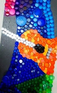 bottle cap mural.  This would be great for our Go Green! curriculum fair in the spring.