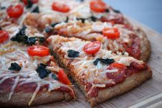 Low Carb Pizza--made with flax seed meal What you will need: 1 1/2 cup of flax seed meal 2 tsp of baking powder 1 tsp of oregano 1 tsp of salt 1/2 tsp of Stevia or natural sweetener 3 eggs 3 tbs of olive oil 1/2 cup of water