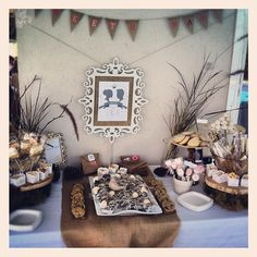 Dessert Table-Copy middle tray (strawberries!), cookies on sides, tall sign behind, 2 pots of marshmallows and/or fondue sticks, long pretzel sticks, oreos on sticks