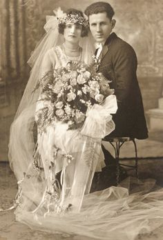 +~+~ Vintage Photograph ~+~+  Gorgeous bride sitting on her grooms lap.