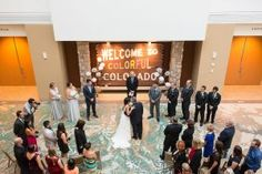 Dramatic and fun wedding ceremony at the History Colorado Center in the heart of Denver, Colorado.