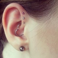 Love the heart piercing: The Daith + Triple Forward Helix | 28 Adventurous Ear Piercings To Try This Summer