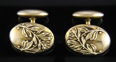 A stylish pair of cufflinks with laurel sprigs and berries.  Since Classical times laurel wreathes have been a symbol of victory and glory.  These elegant cufflinks are well crafted in 14kt yellow gold and date from the easrly 1900s.