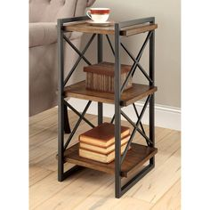 Add an edgy accent piece to your living space without compromising functionality. This end table features an industrial style framework with metal crisscross bars while wood shelves create three easy