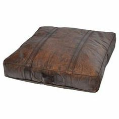 """Wrapped in leather-inspired upholstery and showcasing a distressed finish, this handsome floor pillow brings rich style to your decor.   Product: PillowConstruction Material: LeatherColor: BrownDimensions: 4"""" H x 27"""" W x 27"""" DNote: Due to the vintage nature of this product, some wear and tear is to be expected. Products may show signs of brand marks, scrapes or other blemishes.Cleaning and Care: Wipe clean with a damp cloth"""